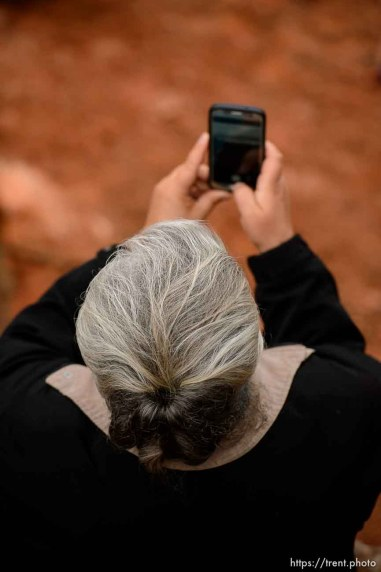 Trent Nelson | The Salt Lake Tribune An FLDS woman films the UEP eviction of property at 560 E Johnson Ave, Colorado City, AZ, Wednesday May 10, 2017.