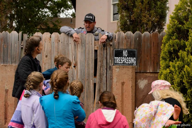 Trent Nelson | The Salt Lake Tribune UEP eviction of property at 555 N Lauritzen Ave, Colorado City, AZ, Wednesday May 10, 2017. Marshal Sam Johnson tells residents they can retrieve their belongings from the yard.