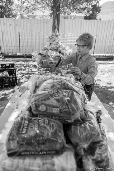 Trent Nelson | The Salt Lake Tribune Ammon Owen stacks bread donated for needy members of the FLDS polygamous sect in Colorado City, Ariz., Saturday July 15, 2017. The Davis County Cooperative Society has been offering service and donations to needy FLDS members who were evicted from UEP homes in Hildale and Colorado City, Ariz.
