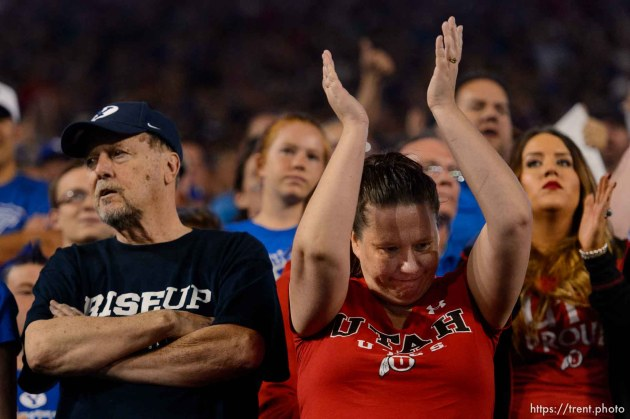 (Trent Nelson | The Salt Lake Tribune) Fans react to a call going in Utah's favor as BYU hosts Utah, NCAA football in Provo, Saturday September 9, 2017.