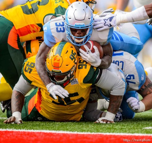 (Trent Nelson | The Salt Lake Tribune) Salt Lake's Branden Oliver (33) tries to go over Arizona's Trenton Thompson (95), but comes up short as the Salt Lake Stallions host the Arizona Hotshots, Alliance of American Football in Salt Lake City on Saturday Feb. 23, 2019.