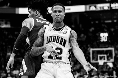 (Trent Nelson   The Salt Lake Tribune) Auburn Tigers guard J'Von McCormick (12) plays air guitar to celebrate a basket as Auburn faces New Mexico State in the 2019 NCAA Tournament in Salt Lake City on Thursday March 21, 2019.