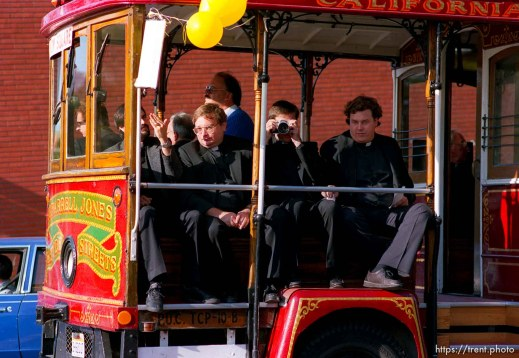 Priests on trolley car (one taking my picture) at the Pope's visit.