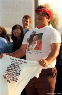 Guy selling Pope t-shirts at the Pope's visit.