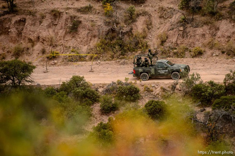 (Trent Nelson | The Salt Lake Tribune) A Mexican military vehicle passes the site where two vehicles were attacked by gunman, killing Dawna Ray Langford and Christina Marie Langford, along with two of Dawna's children (Trevor, 11, and Rogan, 3) near La Mora, Sonora on Friday Nov. 8, 2019.