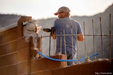 Moroni Draper works to take down a wall in front of the Leroy S Johnson Meetinghouse in Hildale on Friday Nov. 15, 2019.