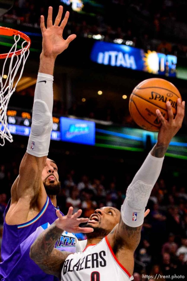 (Trent Nelson | The Salt Lake Tribune) Utah Jazz center Rudy Gobert (27) blocks a shot by Portland Trail Blazers guard Damian Lillard (0) with three seconds remaining, as the Utah Jazz host the Portland Trail Blazers, NBA basketball in Salt Lake City on Thursday, Dec. 26, 2019.