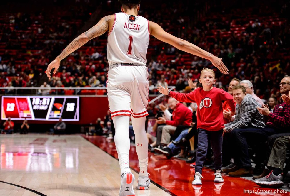 (Trent Nelson | The Salt Lake Tribune) Utah fan Jensen Brain gets a high-five from Utah Utes forward Timmy Allen (1) as the University of Utah hosts Oregon State, NCAA men's basketball in Salt Lake City on Thursday, Jan. 2, 2020.