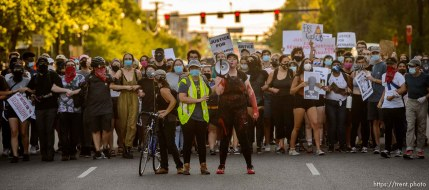 (Trent Nelson | The Salt Lake Tribune) Protesters link arms while facing a police line in Salt Lake City on Thursday, July 9, 2020.