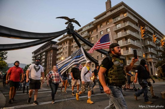 (Trent Nelson | The Salt Lake Tribune) About 300 people in support of police march down State Street in Salt Lake City on Saturday, Aug. 22, 2020.