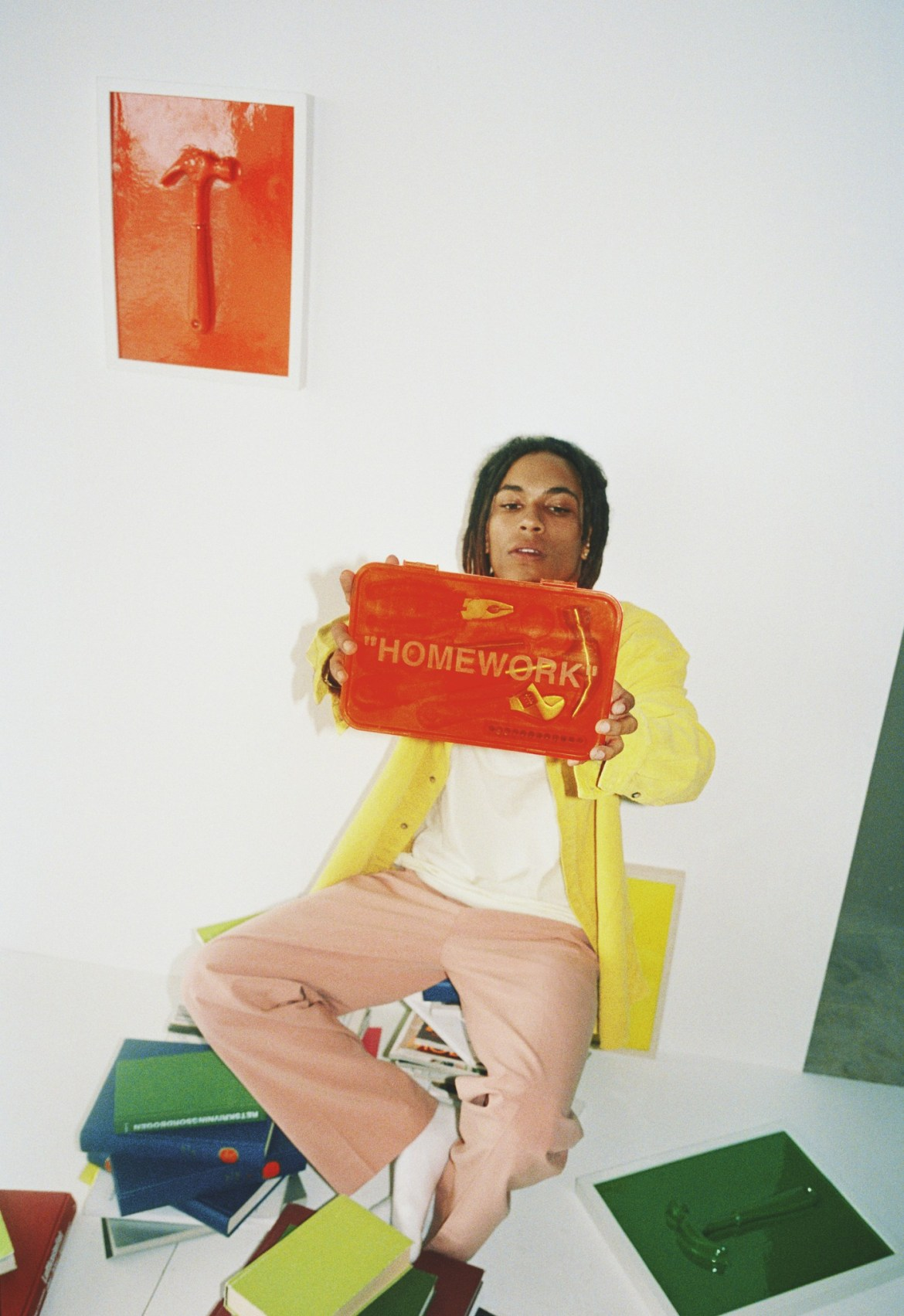 a boy with an Off-White bag