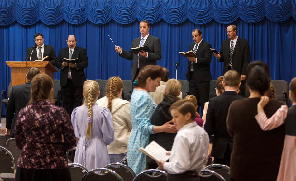 Sam Allred leads the conjuration in a hymn during a church service of ex-FLDS members Sunday, February 17, 2013 in Hildale. Left to right on stage are William E. Jessop, Garth Warner, Allred, Dan Timpson and Royce Jessop
