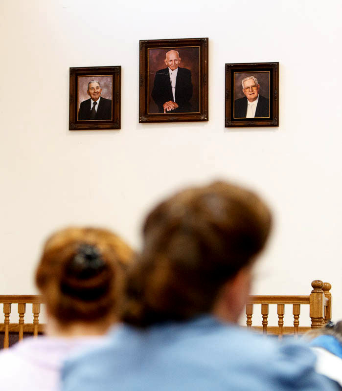 Portraits of former church leaders Parley Harker, Leroy Johnson and Fred Jessop hang on the wall at a church service of ex-FLDS members Sunday, February 17, 2013 in Hildale.