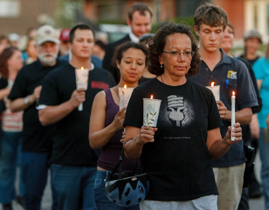 Marchers walk and carry candles in memory of accused cop-killer Matthew Stewart