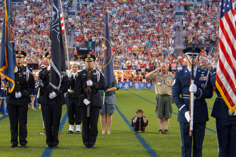 andrew wright covers his ears during presentation of colors and fireworks, stadium of fire