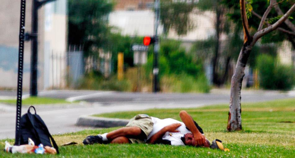 man asleep on grass