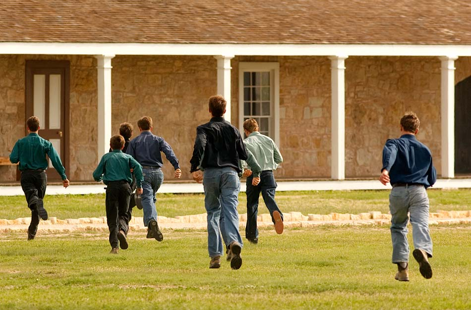 San Angelo, Texas - A group of FLDS boys run from journalists at Fort Concho after being ordered away by Texas Child Protective Services officials. Soon CPS would separate the mothers from their children and spread the children throughout the state into foster care.