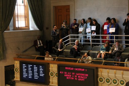 Advocates with TIRRC listen to deliberations on the Senate floor