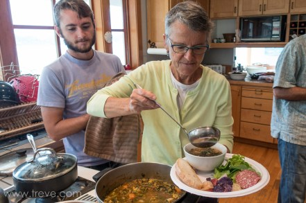Ann serves up some fresh vegatable soup with ingredients from the garden.