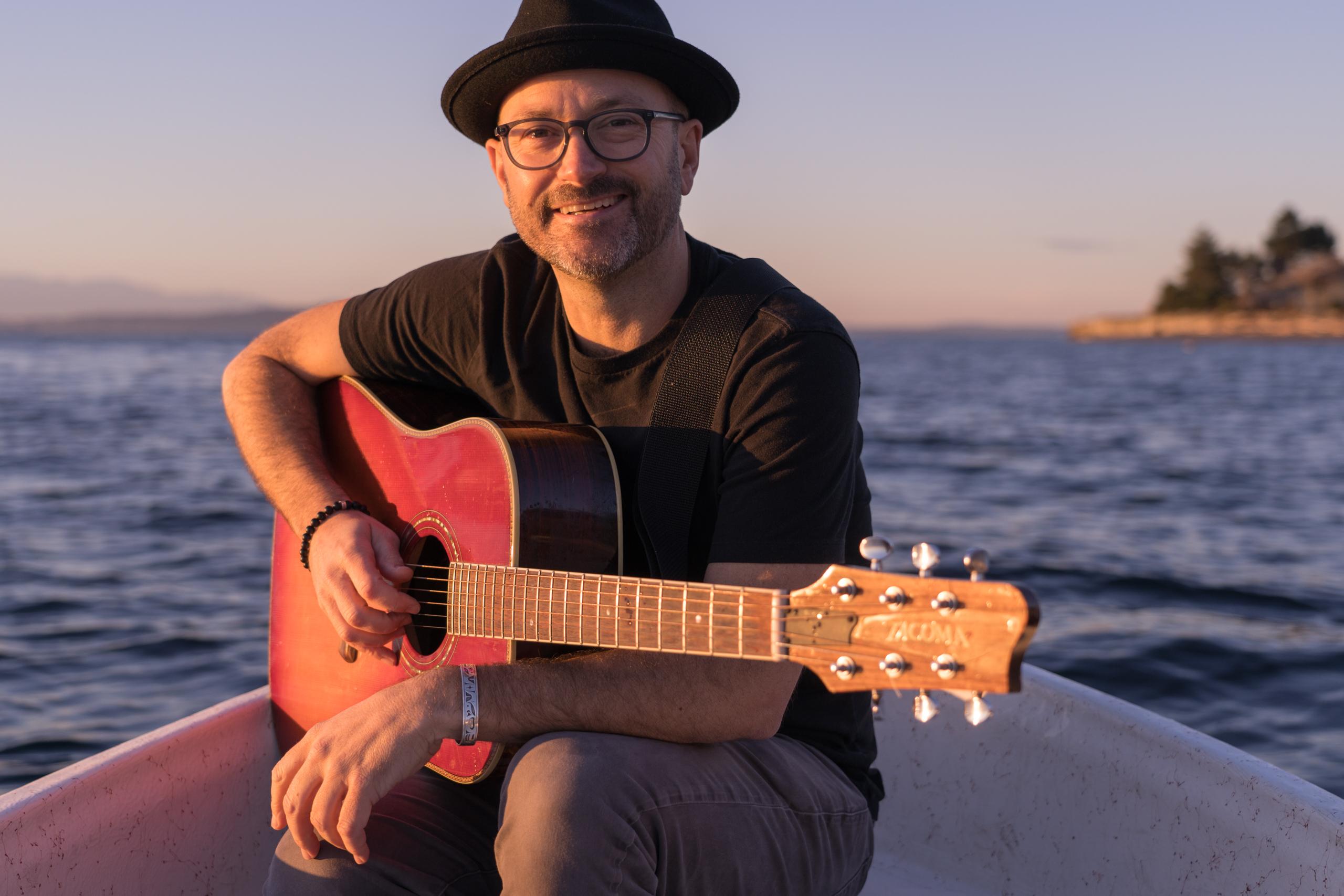Trevor Ras with guitar