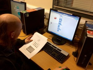 Samuel Freeman setting up the Library systems for Code Club