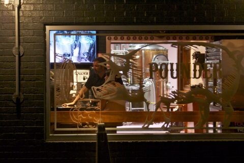 Marty Kotis seen through the window of his brewery after the event.