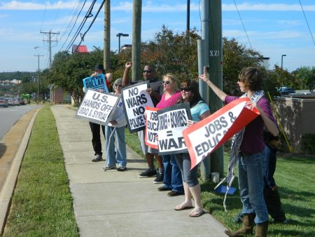 Tony Ndege (third from left) organized an antiwar rally in Winston-Salem on Sept. 27.
