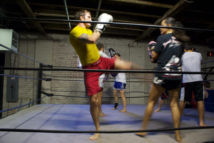 MMA fighter Kyle Martin trains with kickboxer Aracely Valenzuela at Eight Points Muay Thai at the West End Mill Works.