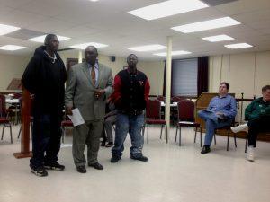 Rev. Nelson Johnson, center, who heads the Beloved Community Center.