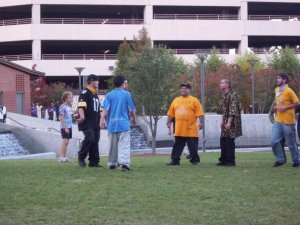 From center facing camera: Jay, Menace and Eric Ginsburg playing touch football at Center City Park