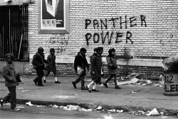 Children walk by Panther graffiti. (courtesy photo)