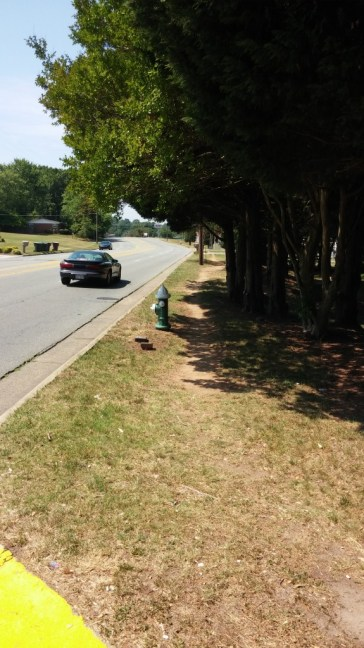 On Greensboro's Yanceyville Street between Lees Chapel Road and Wendover Avenue, pedestrians often must make do with a dirt path in lieu of sidewalks.