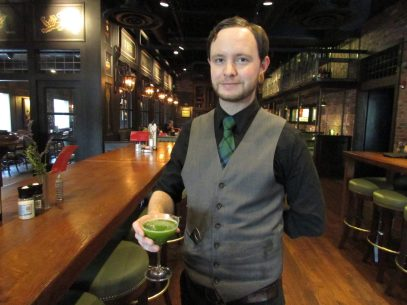 Corey McAdams presents a glass of Pineapple con Verdito, a sweet and refreshing drink with a powerful kick — one of three drinks on the Marshall Free House's mocktail menu.