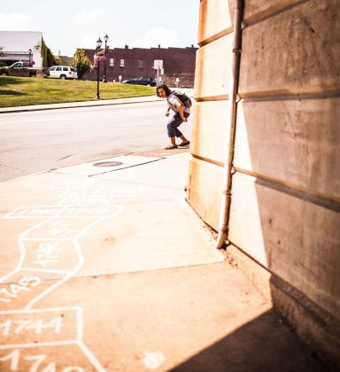 Patrick McDonnell, urban planner and strategist, made sure that Elsewhere's hopscotch grid passed underneath the South Elm Street trestle, which he considers to be the actual gate of the Gate City. (Caleb Smallwood)