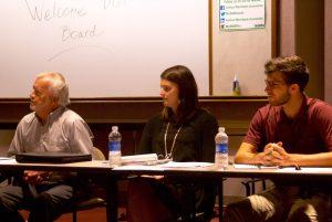 Julia Roach, center, at the recent board meeting