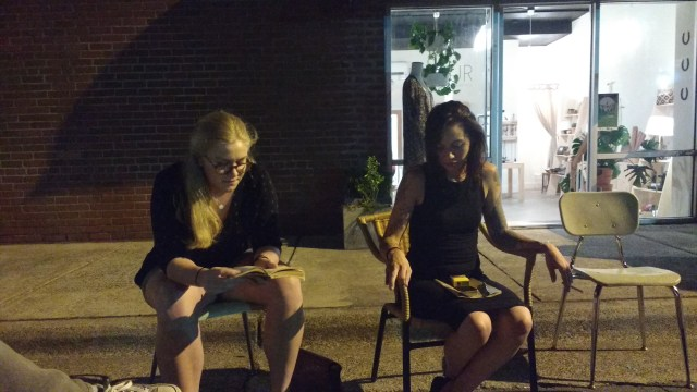 Maddie Himes, left, reads from 'A Room with a View' as Molly Grace listens.