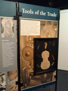 """A panel titled """"Tools of the Trade"""" reveals the minute precision a luthier's craft requires."""