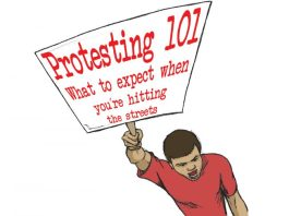 protester-holding-cover-sign