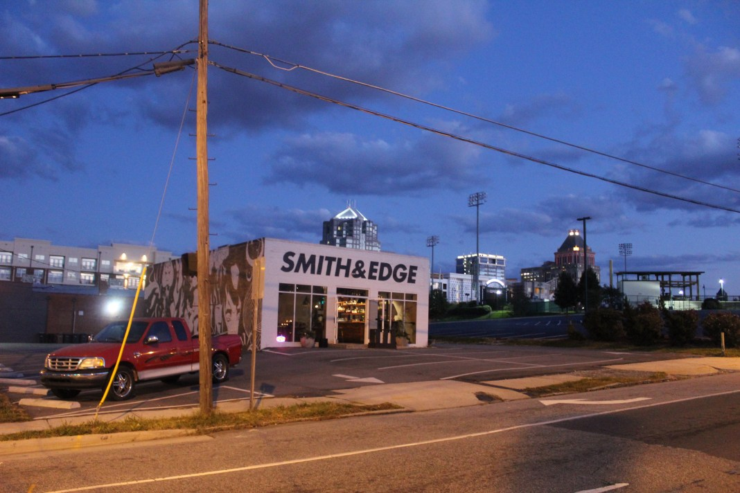 smith-and-edge-bar-with-the-downtown-greensboro-skyline-in-the-background