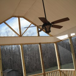 Cathedral ceiling with remote controlled ceiling fan.