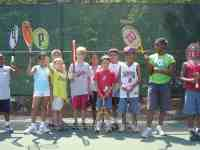 kids with tennis racquets getting ready for free tennis lesson in Raleigh
