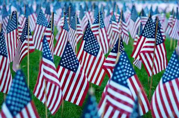 American flags on sticks in ground for Memorial Day