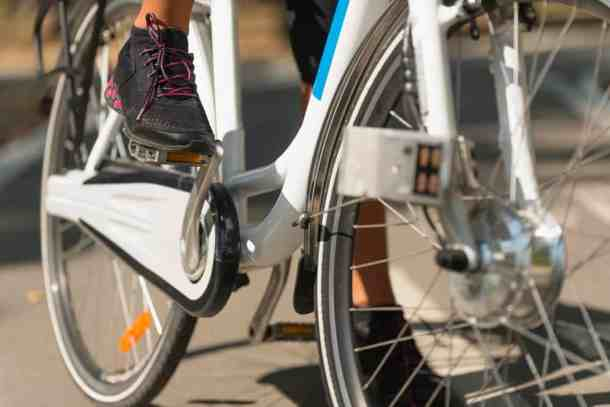 Closeup of foot on pedal of electric bike