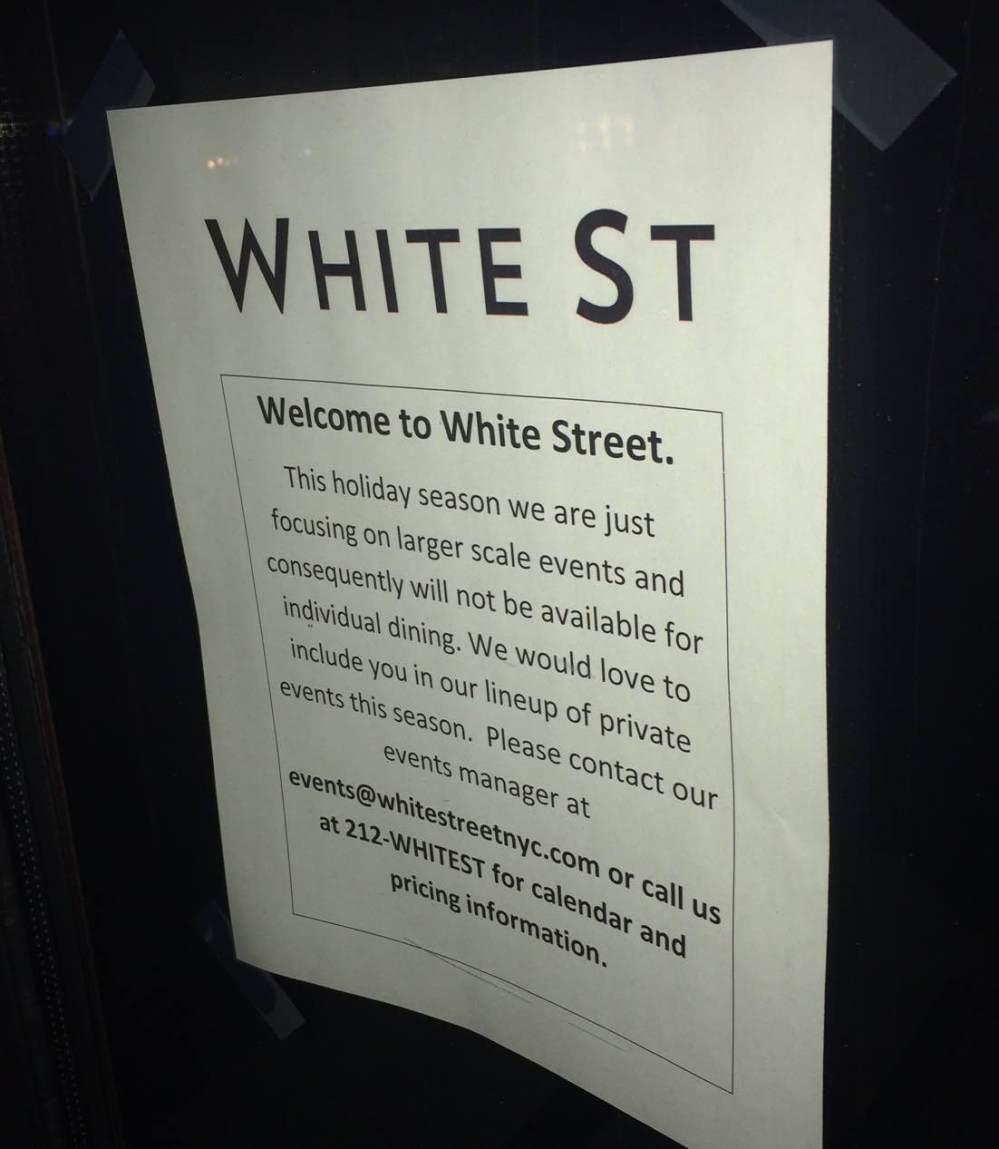 medium resolution of white street restaurant sign