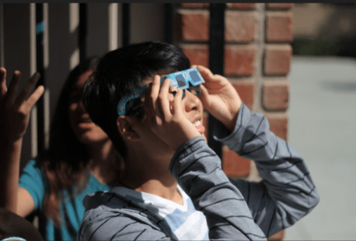 Senior Bill Chen watches the solar eclipse. Photo by Camille Salud.