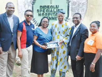 Ambassador (Dr) Olatokunbo Awolowo Dosumu, Co-Chairman, African Newspapers  of Nigeria (ANN) Plc (3rd left), receiving  a donation on behalf  of Dideolu Specialist Hospital, Ikenne, Ogun State from Professor Oladipo Akinkugbe (3rd) right); while Dr Adewumi Adebowale (left), Dr Tolu Adewole (2nd left) and Dr (Mrs) Adenuga Bukola (right) watch.