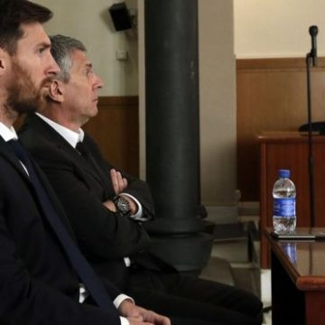 Lionel Messi and his father during his hearing on tax fraud in June 2016.