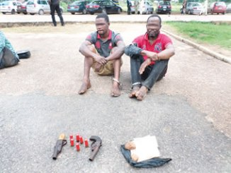 The suspects, Felix Ademola (right) and Ayowole Philips