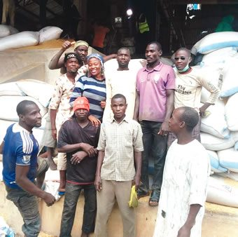 Nigerian Tribune's Ruth Olurounbi with workers at Labana Rice Mills Limited, Birnin Kebbi, Kebbi State.
