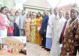 Governor Ifeanyi Ugwuanyi (sixth left) in a group photograph with women group and others at the Government House in Enugu.